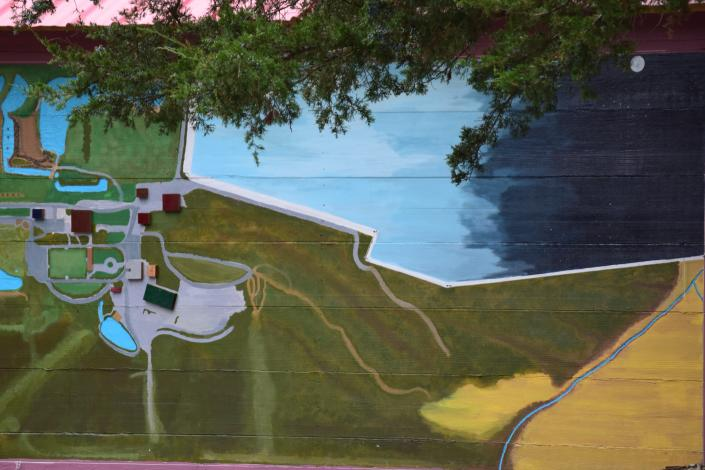 "[Image: We are implementing a 3-D mural to allow you to get your bearings straight on our 40acre property!  Below the mural, we have put in a ""childrens' sidewalk"" for them to draw on (which is within a foot of our childrens' playground !  Lots of amenities for all ages!]"