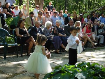 guests adoring the ring bearer and flower girl!